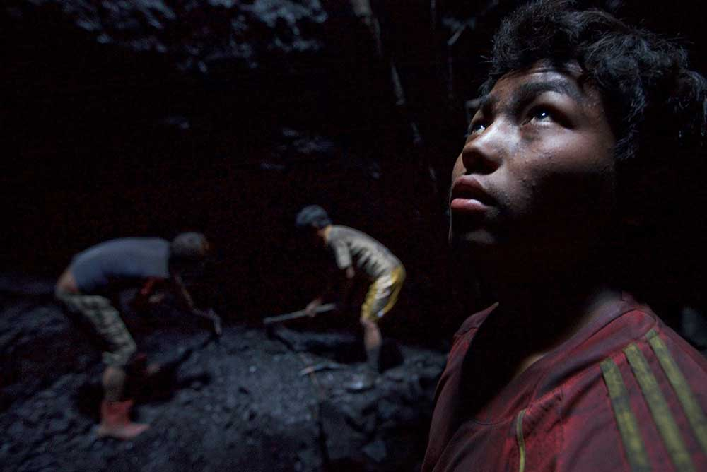 Young miner in Khliehriat, India, 2013.
