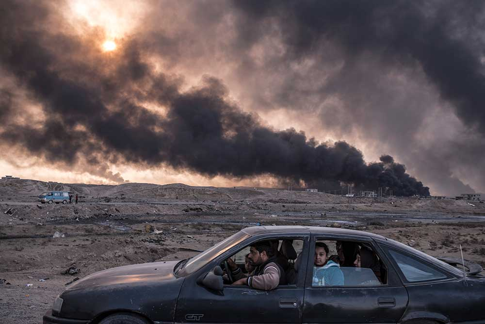 Burning oil fields in Qayyara, Iraq, 2016.